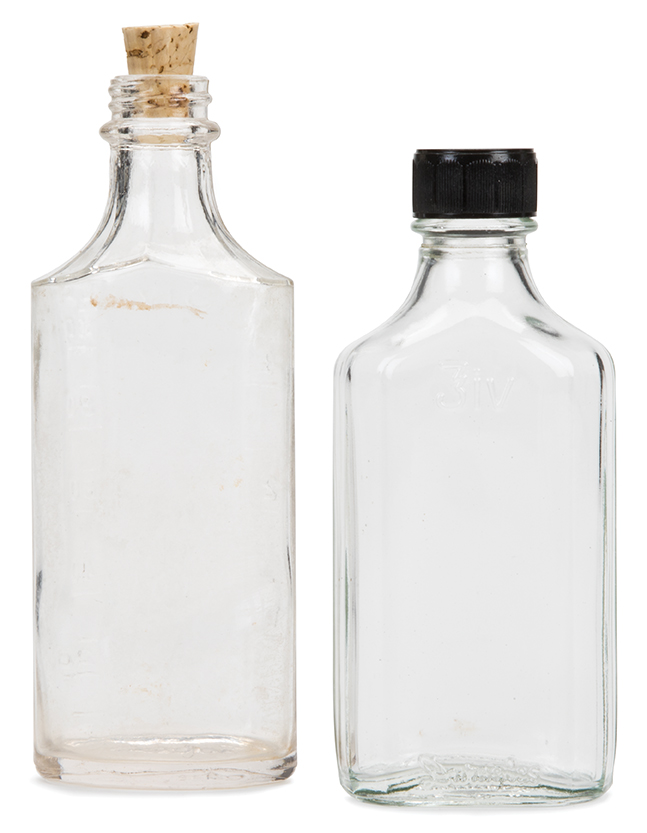 """Haymitch Abernathy"" and ""Katniss Everdeen"" (2) liquor bottles from The Hunger Games: Catching Fire ."