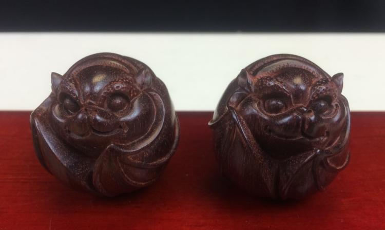PAIR OF ZI-TAN WOOD CARVINGS