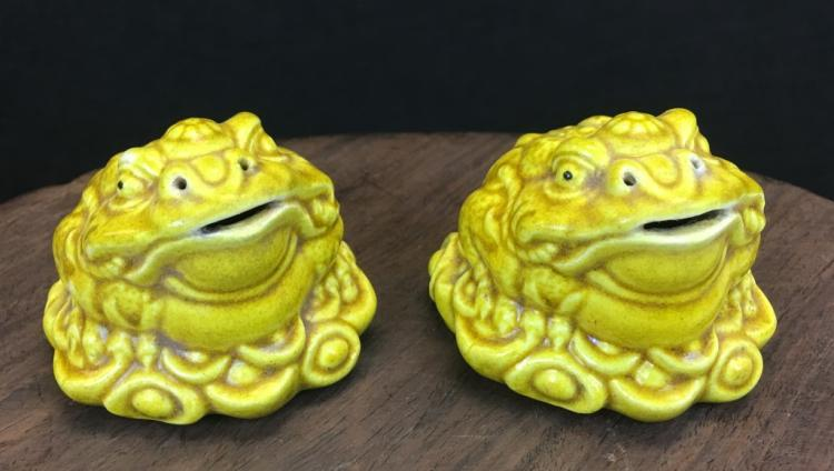 PAIR OF YELLOW GLAZED PORCELAIN PAPER WEIGHTS