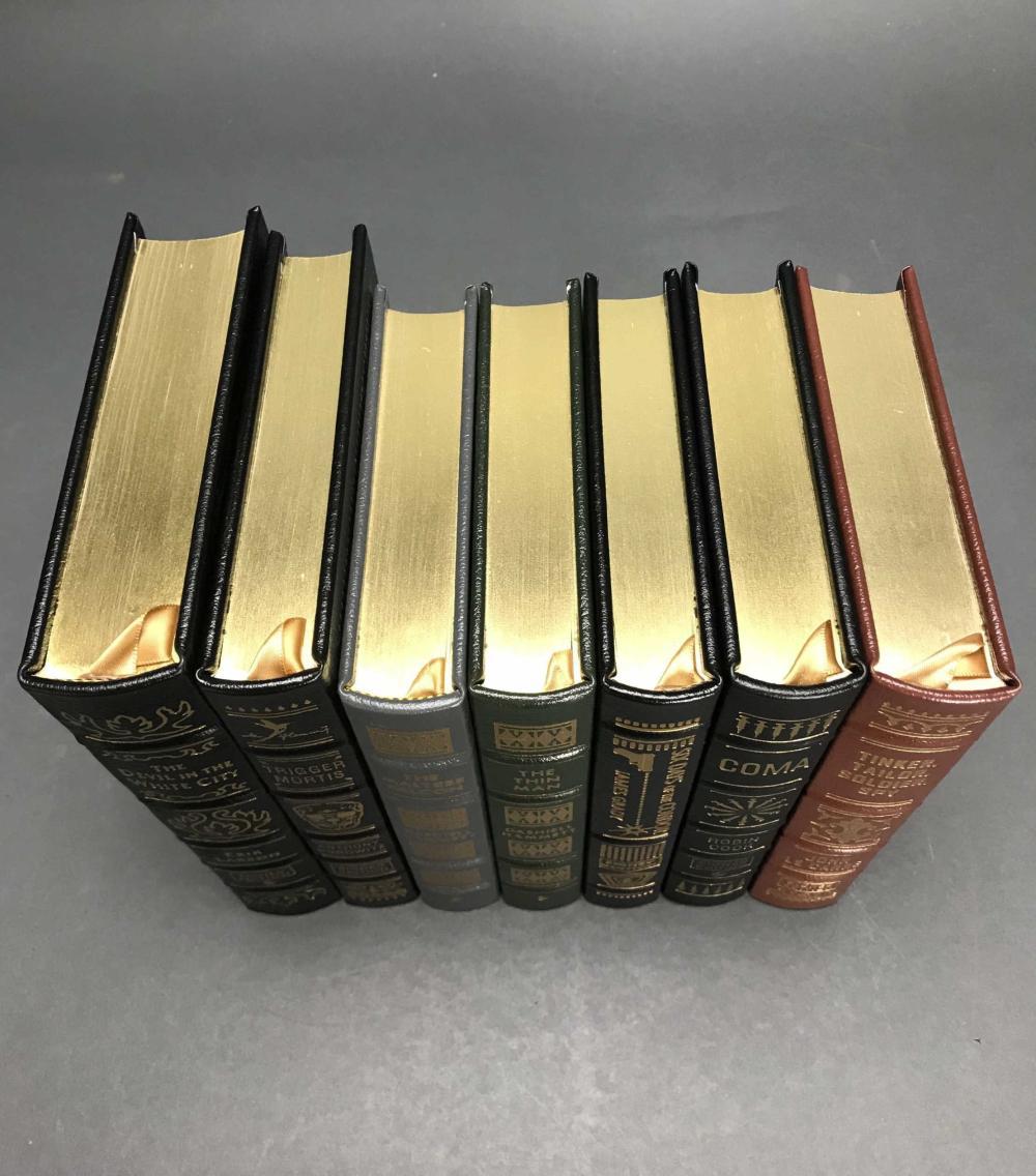 Lot 156: 7 vols. Easton Press. Spy and Thriller Novels. Sgd