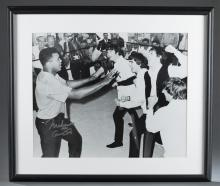 Lot 105: Beatles meeting Muhammad Ali Photo. Sgd by Ali.
