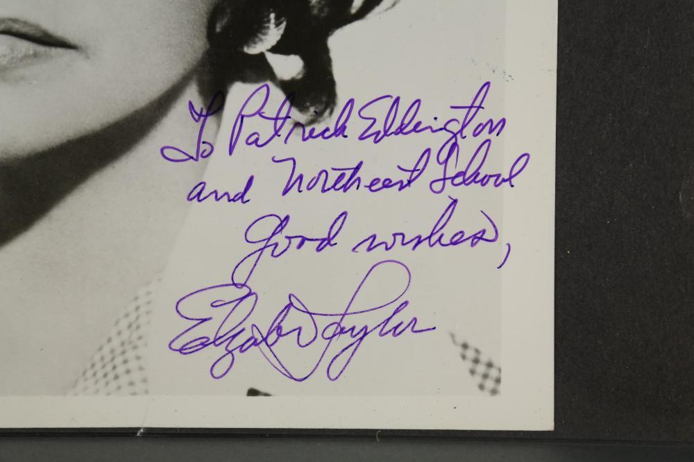 Lot 122: Signed photo of Elizabeth Taylor.