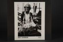 Lot 38: Signed photo of Ray Charles.