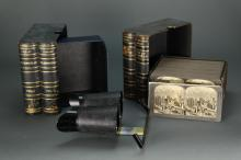 Lot 286: Stereoscope Viewer & 101 Slides in 2 boxes.