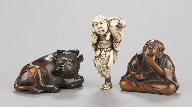 A group of three netsuke of various materials.
