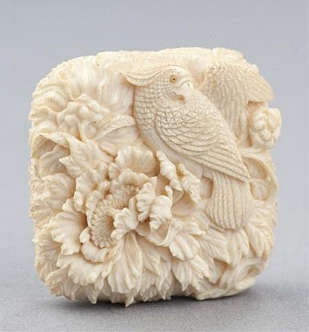 A fine ivory manju of a parrot.