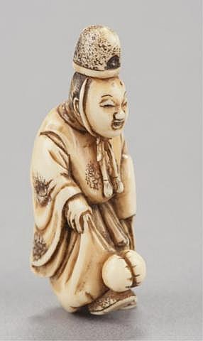An ivory netsuke of a court noble.