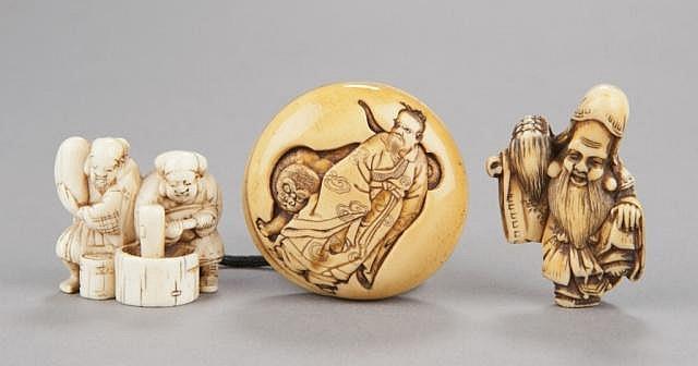 A group of three ivory netsuke.