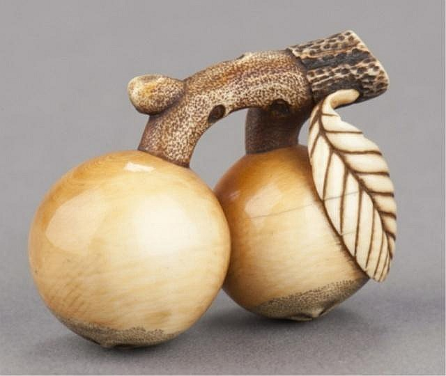 An ivory netsuke in the form of loquats.