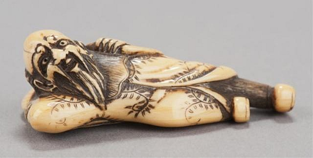 An ivory netsuke of a Dutchman.