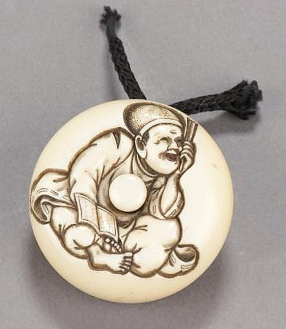 An ivory manju of a Noh play prompter.