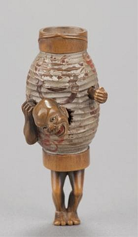 A boxwood netsuke of the Ghost of the lantern.