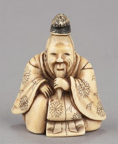 An ivory netsuke of a seated Court figure.