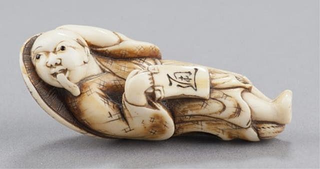 An ivory netsuke of a Tanuki.