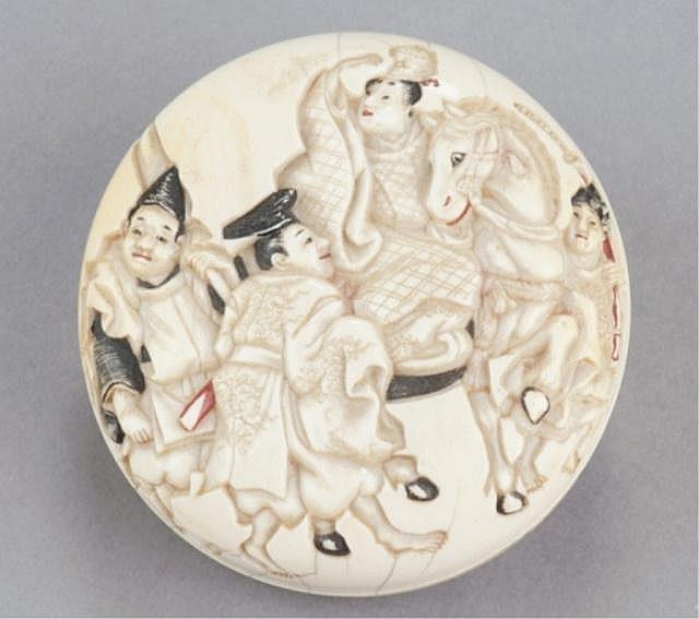 An ivory manju of a nobleman on horseback.