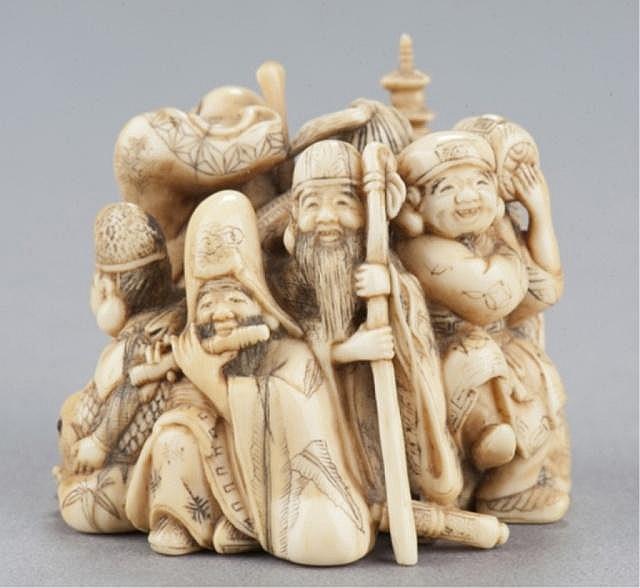 An ivory netsuke of the Seven Happy Gods.