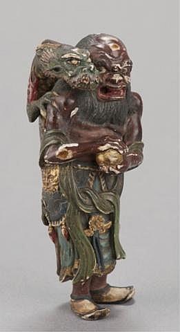 A painted wood netsuke of Ryujin, the Dragon King.
