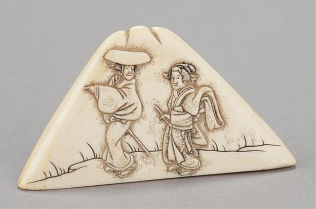 An ivory netsuke in the form of Fuji Yama.