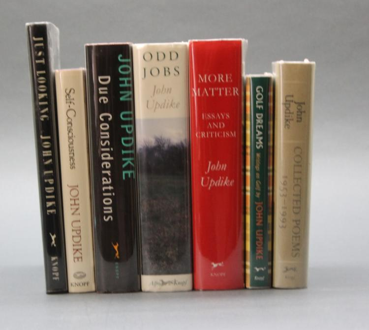 7 books signed by Updike incl: JUST LOOKING.