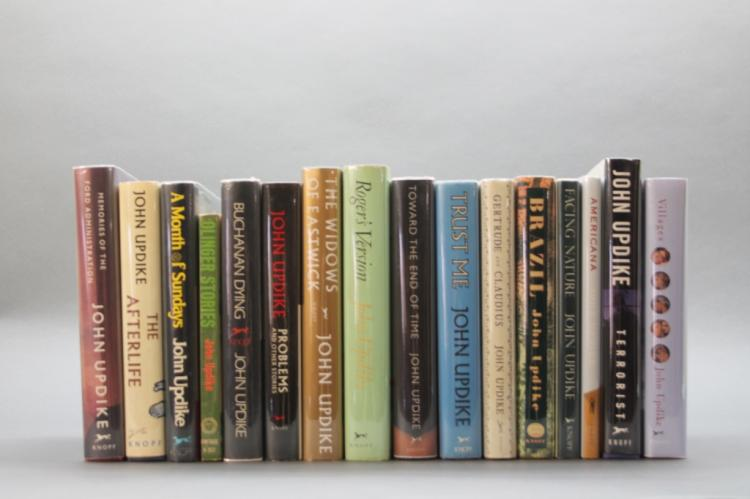 16 books signed by John Updike.