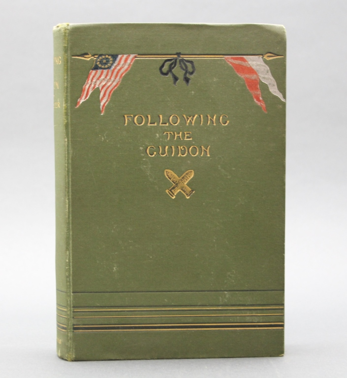 FOLLOWING THE GUIDON. Inscribed by R. G. Carter.