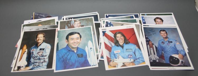 35 sgd photographs by NASA Shuttle astronauts.