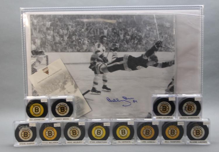 Sgd. Boston Bruin Bobby Orr photo & 12 sgd. pucks