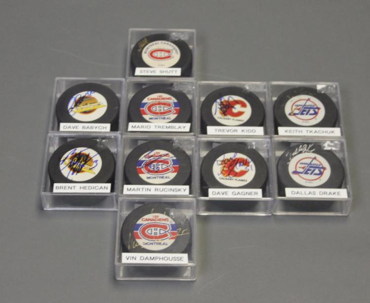 10 signed NHL pucks from 4 Canadian teams