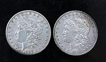 U.S. Morgan Dollar Coins Two United States Morgan dollar coins. 1900 and 1903. Both are in plastic display cases.Condition: Good.