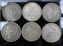 A lot of Morgan Silver Dollars. A  lot of 6 Morgan Silver Dollars. 1896-O, 1882-O, and 1921-S.