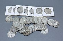 A lot of Franklin Half Dollars. A lot of 41 Franklin half dollar coins.Condition: good.