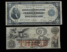 A set of obsolete notes: 1918 $2 & 1853 $3 A set of obsolete notes. One 1918 $2, Federal Bank of Cleveland, OH and one 1853 $3, The Cochituate Bank of Boston, MA. In good condition: significant amount of creasing, good margins and some soiling.