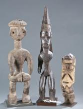 A group of three wooden figures.