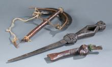 Group of three handheld African items.