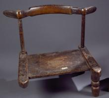 A wooden chair and tool.