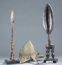A group of three African objects.