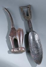 A group of two wooden African objects.
