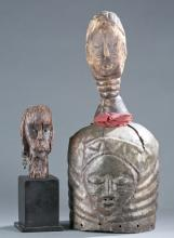 A group of two African figures.