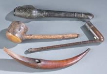 A group of pipes and utensils