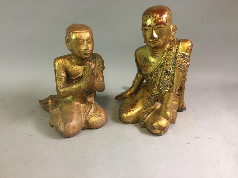 Two South East Asian Gilt Painted Wood Buddha