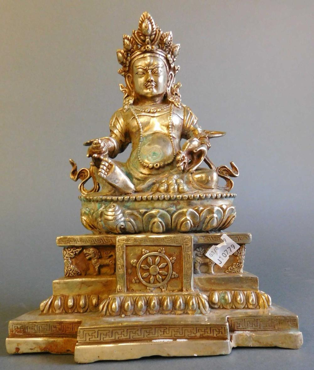 Buddha w/ metal exterior, hollow interior.