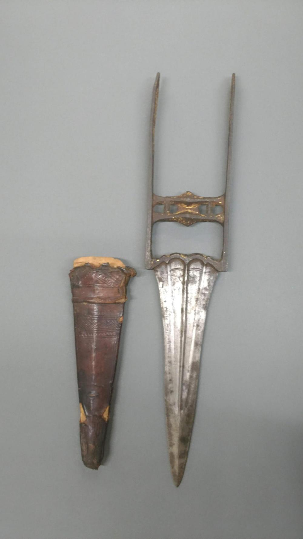 An Indian Katara or push dagger. Double edged blade and gilt detail on handle. Comes with leather scabbard.
