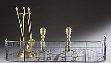Baroque style andirons, wire fender, tools.