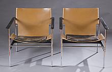 A pair of Pollock model 657 chairs.