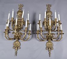 Pair of George III style bronze wall sconces.