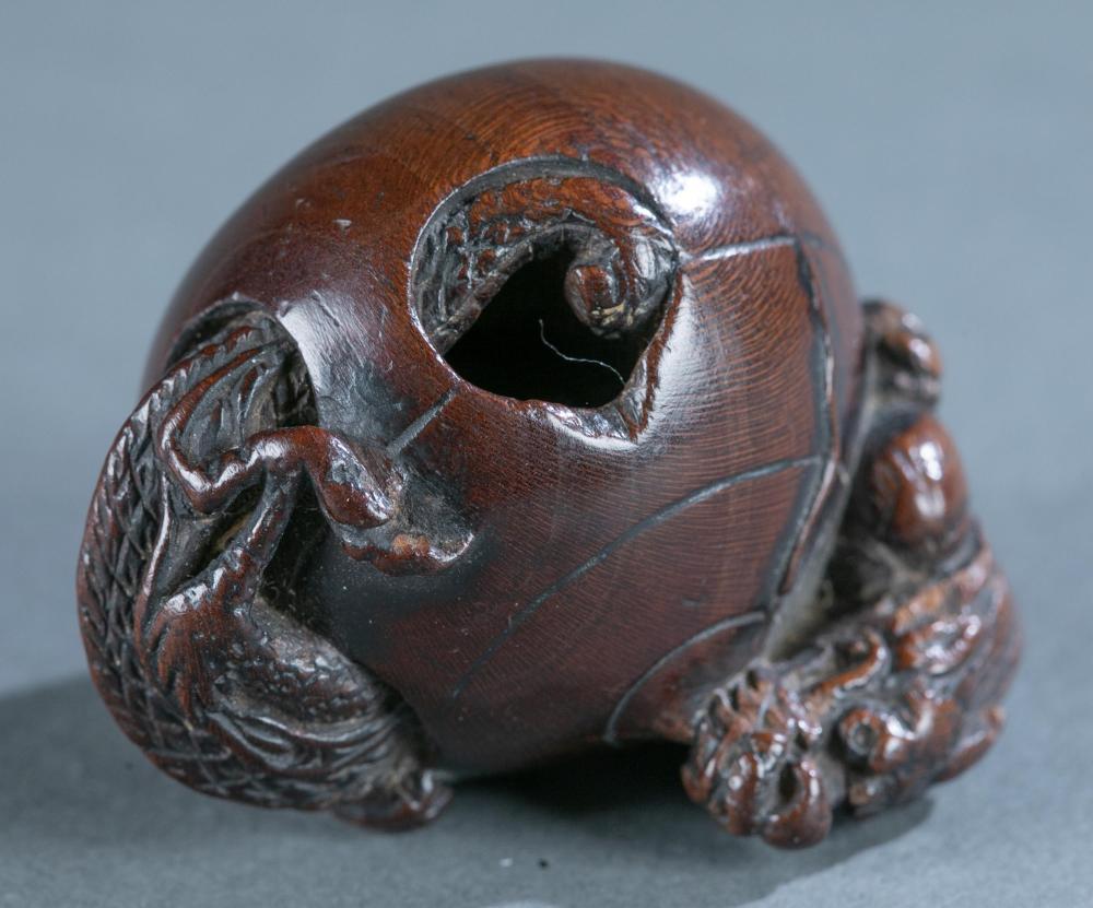 Wood netsuke of dragon in jewel, 19th century.