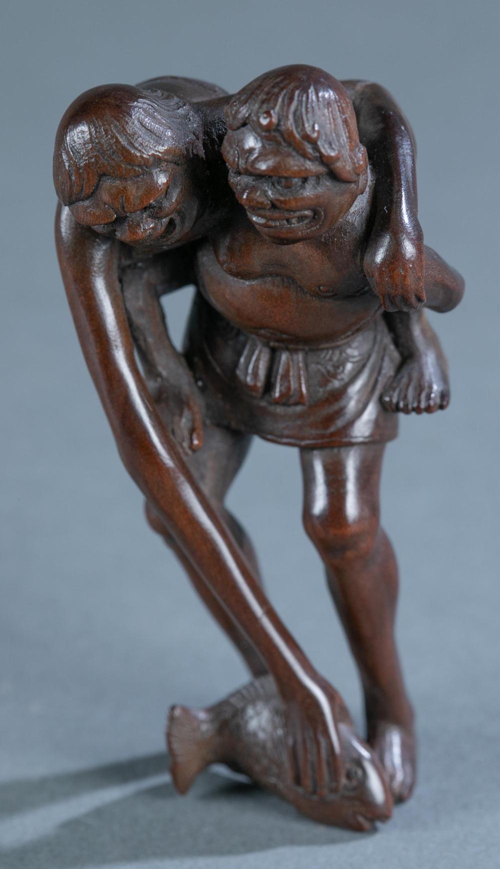 Seigyoku: wood netsuke of pair of Yokai, 19th C.