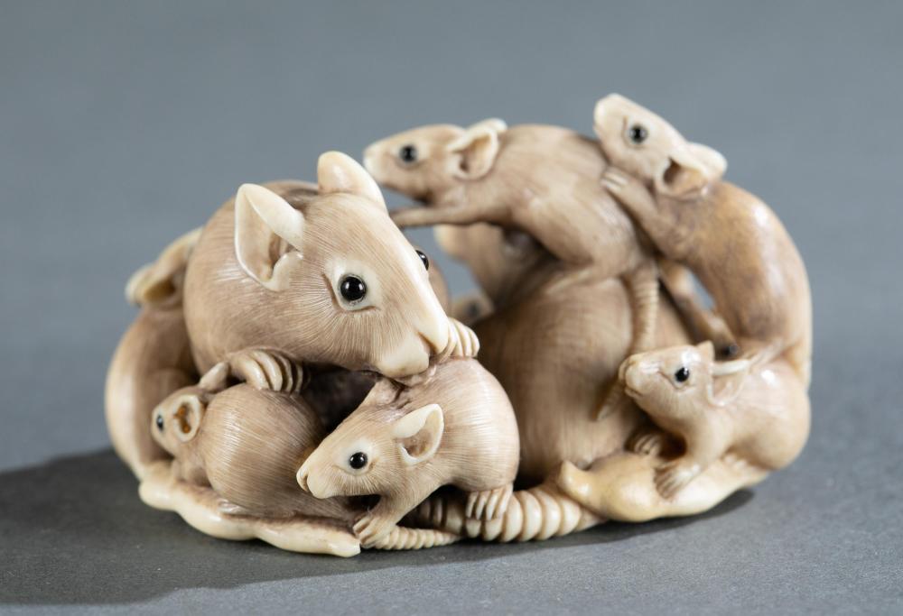 Ivory okimono rat group on snow peas, late 19th C.