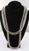 2 Silver bead necklaces.