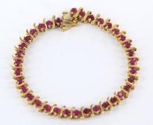 Ladies yellow gold and ruby tennis bracelet